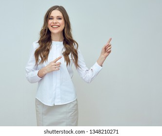 smiling businesswoman pointing with finger at copy space. isolated studio portrait.