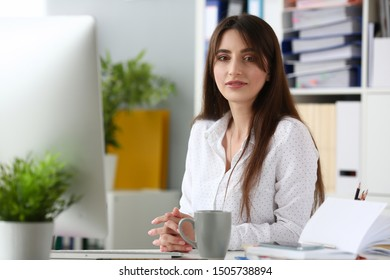Smiling businesswoman portrait sit table aganist modern office background. Business education concept