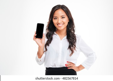 Smiling businesswoman showing blank smartphone screen over white background