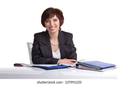 smiling  businesswoman sitting with papers on white background