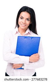 Smiling businesswoman standing with folder over white background and looking at camera