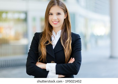 Smiling businesswoman in an urban setting