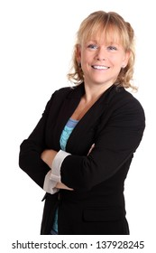 Smiling businesswoman wearing a jacket, her arms crossed. White background.