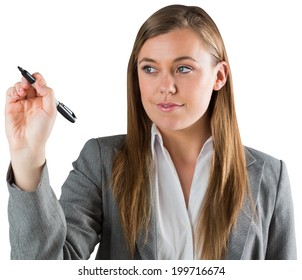 Smiling businesswoman writing with pen on white background