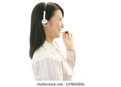Smiling call center operator.