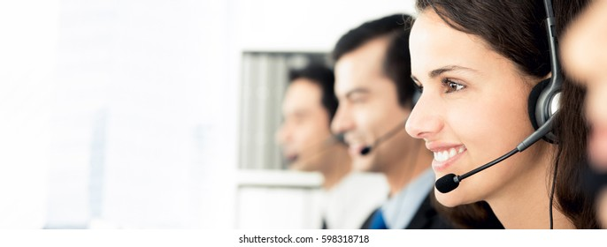 Smiling call center team, panoramic banner with copy space