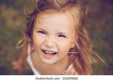smiling camera looking running child