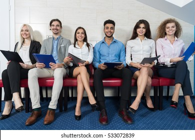 Smiling Candidates Wait For Job Interview, Mix Race Business People Sitting In Line Human Resources Hiring Vacancy Recruitment