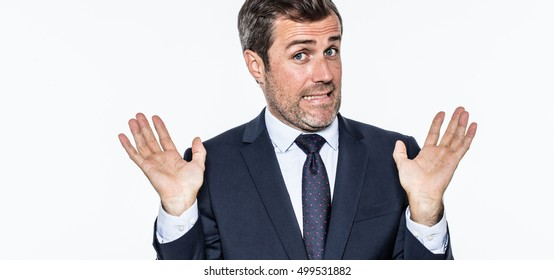 smiling careless bearded businessman refusing accusation, acting like an hypocrite, coward or irresponsible for corporate faults, isolated, white background