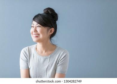 Smiling casual Asian women