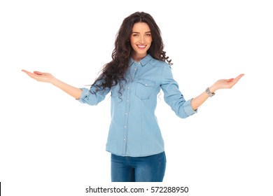 smiling casual woman welcoming you with hands outstretched on white background