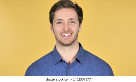 Smiling Casual Young Man Isolated on Yellow Background