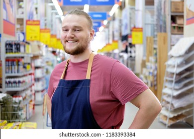 Smiling caucasian bearded salesman at construction super store portrait