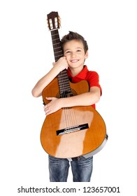 Smiling caucasian boy is playing the acoustic guitar - isolated on white background
