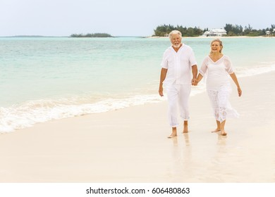 Smiling Caucasian senior retired couple in white casual clothes outdoor together on luxury Caribbean vacation beach