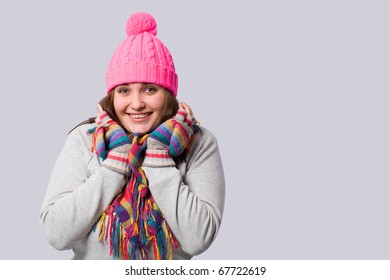 Smiling charming brunette in winter clothes