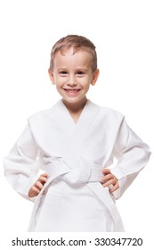 Smiling charming kid in brand new kimono on isolated white