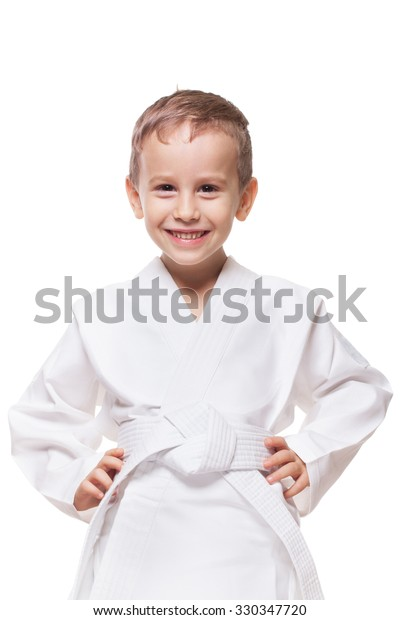 Smiling charming kid in brand new kimono on isolated white