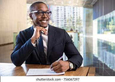 Smiling cheerful happy african american male business executive sales representative at luxury building lobby