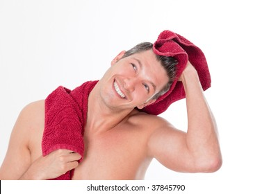 Smiling cheerful man drying hair after shower