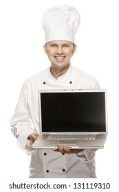 Smiling Chef holding a laptop, isolated on white
