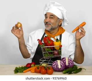 smiling chef  with shopping cart
