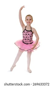 Smiling Child Ballerina Performs Tendu in Recital Tutu Costume