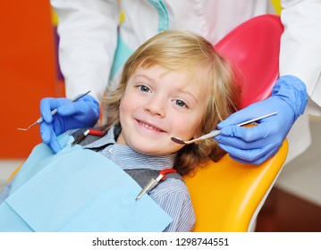 smiling child with blonde curly hair on examination in the dental chair. Pediatric dentistry