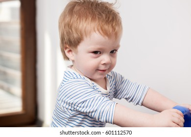 Smiling child boy at his home. Little boy having fun