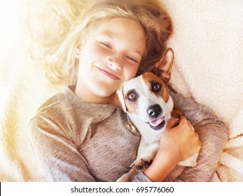 Smiling child with dog. Portrait girl with pet