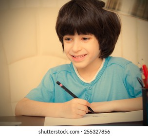 smiling child doing homework with computer, portrait. instagram image retro style