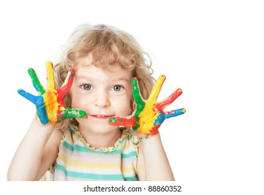 Smiling child with finger paint