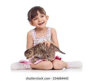 smiling child girl holding cat kitten isolated