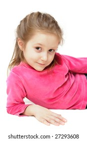 smiling child girl is lying leaning on elbow and looking to the camera