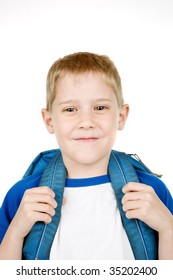 A smiling child has a backpack. Could be going to school, a camping trip or on a sleep over.