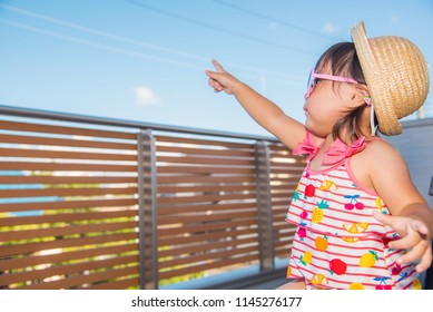 Smiling child on the balcony