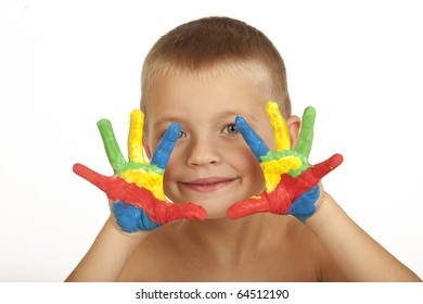 Smiling child with painted hands (focus on hands)