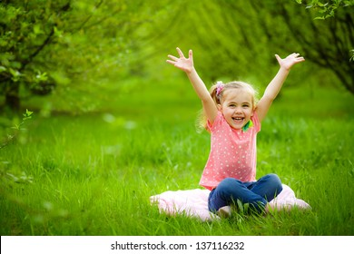 smiling child playing in the garden