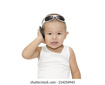 Smiling child with sunglasses and hand cell phone portrait studio