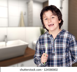 Smiling child without a toothbrush in the bathroom