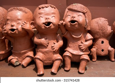 Smiling Children Clay Dolls  (Taking from Public Area, No Property Release Required)
