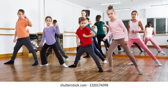 Smiling children dancing contemp in studio smiling and having fun
