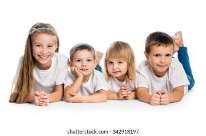 smiling children lying on the floor isolated on white background