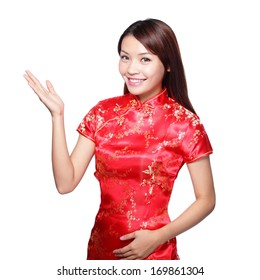 e5497bce47ce81 Smiling Chinese woman dress traditional cheongsam and introduce on white  background.