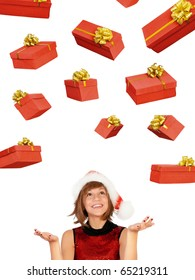 Smiling christmas girl catch gifts wearing Santa hat. Isolated on white background.