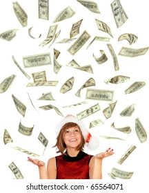 Smiling christmas girl catching falling dollars banknotes wearing Santa hat. Isolated on white background.