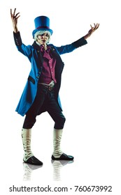 Smiling circus actor in blue tuxedo is presenting something. Isolated on white.