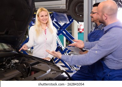 Smiling client satisfied with mechanics renewal result