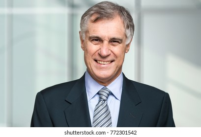Smiling confident business man portrait