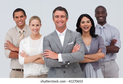 Smiling and confident business team standing against white background